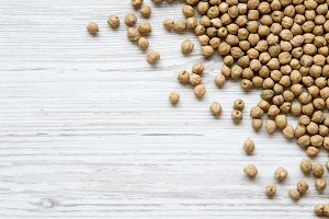 Chickpeas on white wooden table
