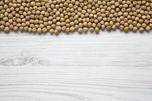 Dried chickpeas on white wooden