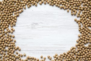 Frame of dried chickpeas on white