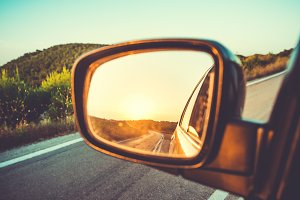 Sunset in sideview car mirror