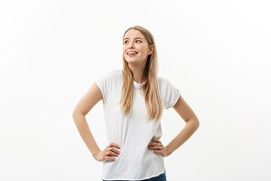 Lifestyle Concept: Portrait of happy blond surprised young woman on white background.
