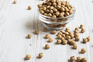Bowl of dried chickpeas on a white