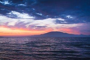 Dramatic sky over the sea and island