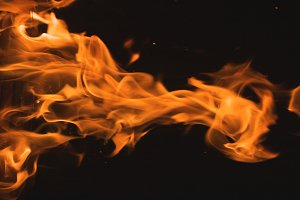 Dramatic Flames Against A Dark Background