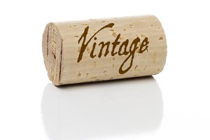 Vintage Branded Wine Cork Isolated on a White Background.
