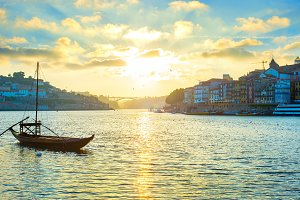 Porto skyline at sunset, wine boat