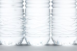 Water Bottles Abstract Image on a Gradated White Background.