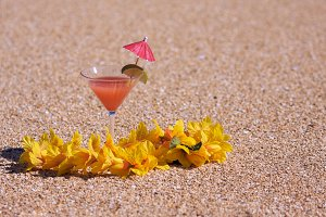 Tropical Drink on Sandy Beach Shoreline