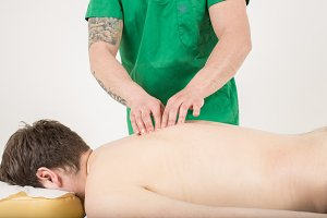 Masseur doing an back massage