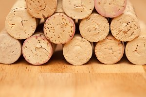 Stack of Wine Corks on a Wood Surface.