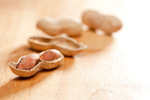 Peanuts on Wood Background with Dramatic Lighting.