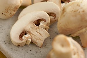 Delicious Fresh Sliced Mushrooms on a Cutting Board.
