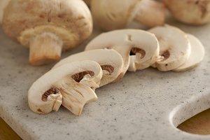 Delicious Fresh Sliced Mushrooms on a Cutting Board.