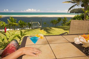 Woman with Tropical Drinks on Lanai
