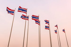 Thai flags waving at sunset time