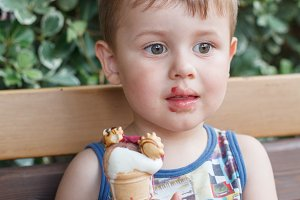 Sweet little boy, eating ice cream