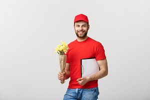 Portrait of happy flower delivery man holding clipboard on white background
