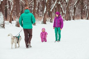 Happy family winter walk