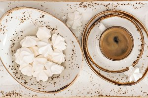 Black coffee with meringue cookies