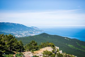 Aerial panoramic view of the city of Yalta in Crimea, Russia. Ayu-Dag or Bear Mountain in the background. Landscape of the South coast of Crimea.