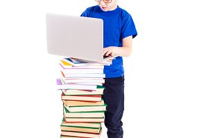 Boy with books and laptop