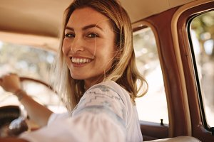 Beautiful female driving a old car