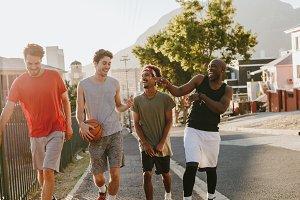 Basketball guys walking on pavement