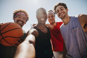Men playing basketball posing