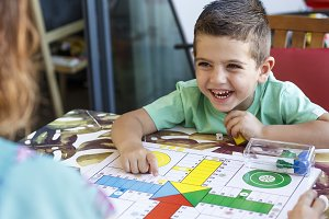 Little boy playing ludo