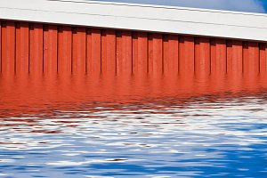 Bright Red Siding House in water
