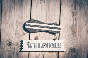 Wooden welcome sign in rustic style