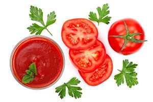Tomato juice in glass and tomatoes with parsley leaves isolated on white background. Top view. Flat lay