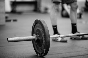 CrossFit Barbell Weights and Athlete