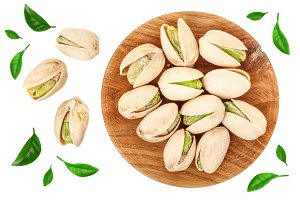 Pistachios in wooden bowl isolated on white background, top view. Flat lay