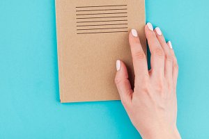 Woman hands holding craft paper
