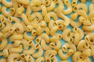 background of pasta in the form of tubes spun in a spiral