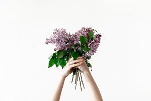 Girl hold bouquet of lilac