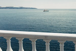 balustrade overlooking the sea and y