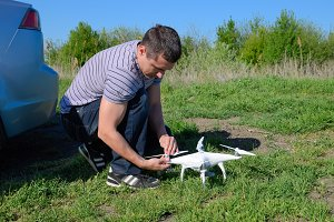 Man Preparing for the flight of the drone. Preparation of the drone.