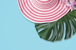 Female summer romantic hat and palm leaf. Holiday travel concept