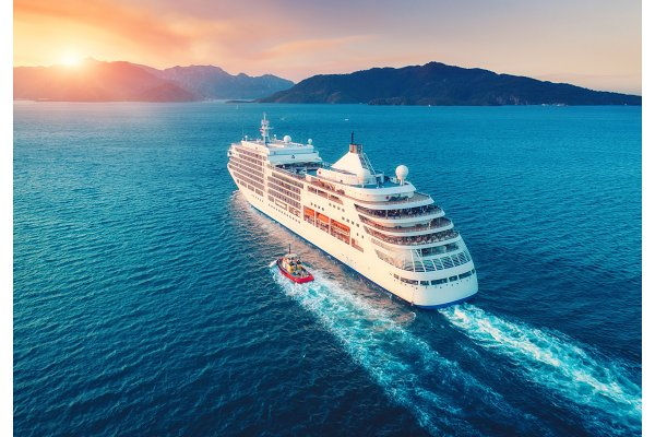 Transportation Stock Photos - Aerial view of beautiful large white ship at sunset