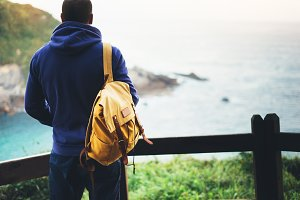 Traveler with a yellow backpack