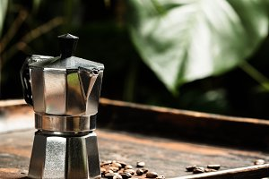 Coffee and tropical leaves background
