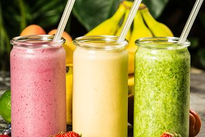 Fresh smoothies on tropical background
