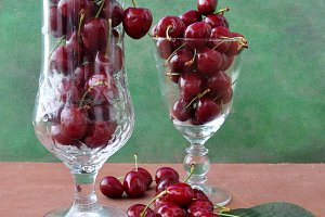 Two glasses with cherries
