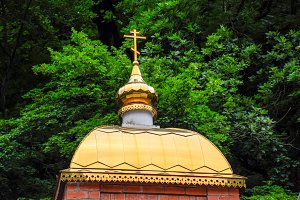 The gilded dome of the Orthodox church. Religious construction and architecture