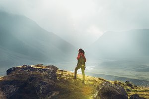 Hiker Woman With Backpack Rises To