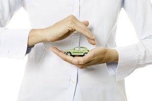 hands holding a miniature car