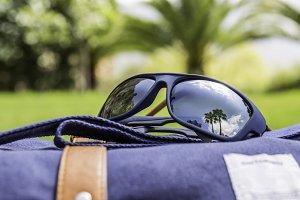 sunglasses and backbag
