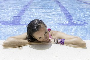 woman resting on pool edge